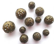 Hollow spacer beads x 11. 4 sizes - 7mm - 14mm. Antique Bronze
